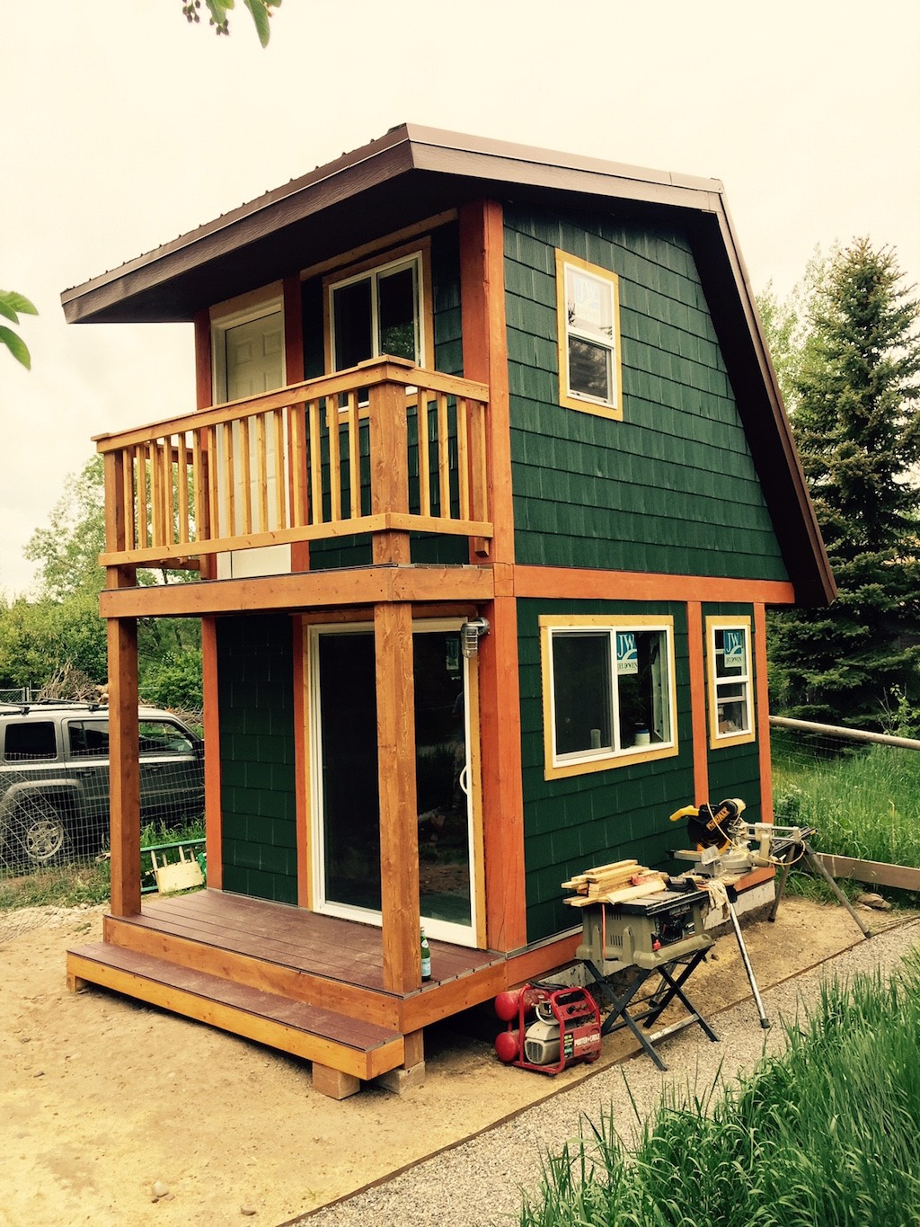 The spacious elegant two story tiny house tiny houses for Cheapest 2 story house to build